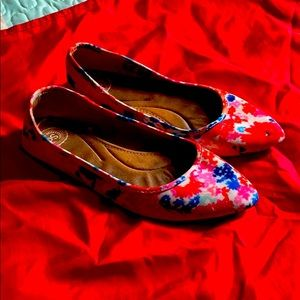 Funky flats with a brightly colored floral design